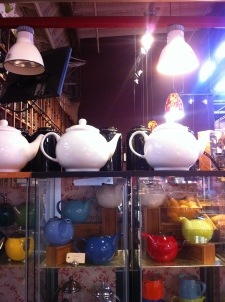 Normal sized teapots on the bottom, awesome sized teapots on the top
