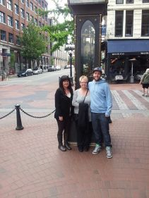 Andrea, Ann and Rob in front of the Steam Clock in Gastown
