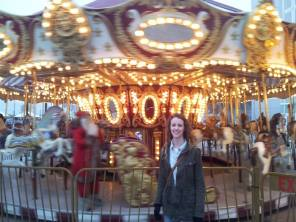 In front of the moving Carousel