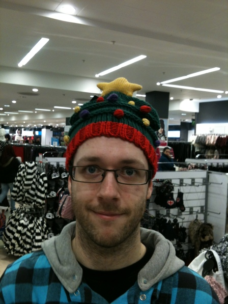 Rob trying on a funny hat in Primark